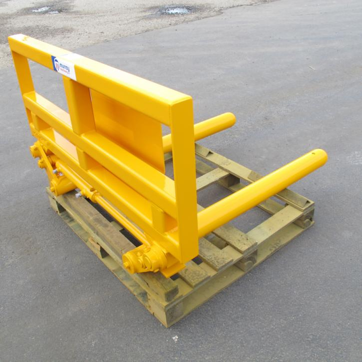 Murray Machinery Wrapped Bale Handler for handling and stacking wrapped round silage bales.