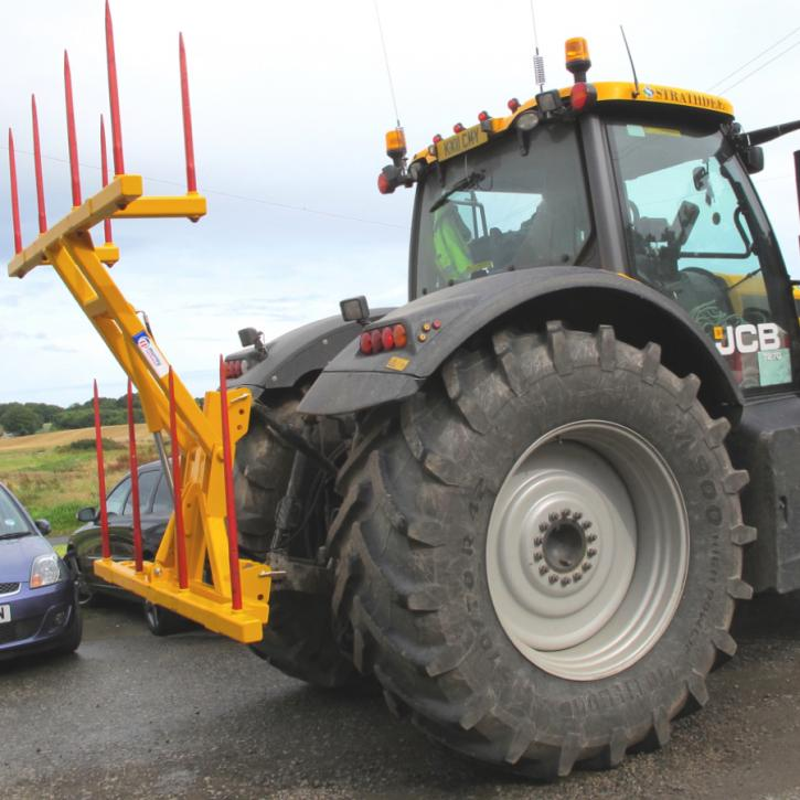 Hydraulically folding Big Bale Transporter for the back of tractors.